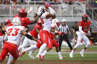 New Mexico Lobos linebacker Evahelotu Tohi (45) intercepts a pass intended for UNLV Rebels wide receiver Darren Woods Jr. (10) during their NCAA football game Saturday, October 6, 2018, at Sam Boyd Stadium in Las Vegas.