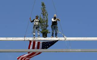 Iron workers pose on the steel beam during a topping out ceremony at the Las Vegas Ballpark in Summerlin Thursday, Oct. 11, 2018. The stadium is scheduled to be completed before the team's season opener on April 9, 2019.