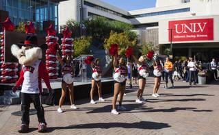 Hey Reb! and UNLV cheerleaders perform during a campus spirit rally for the inaugural Rebels Give fundraising challenge in front of the Student Union building at UNLV in Las Vegas on Thursday, Oct. 11, 2018.