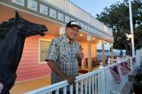 Brothel owner and Assembly candidate Dennis Hof poses outside the Moonlite BunnyRanch brothel in Mound House, six miles east of Carson City, in this June 16, 2018, file photo. Hof died Tuesday, Oct. 16, 2018, at age 72.