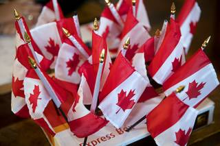 Canadian flags are displayed at the Cheba Hut restaurant during a celebration of Canada's marijuana legalization Wednesday, Oct. 17, 2018. Recreational marijuana became legal in Canada Wednesday.