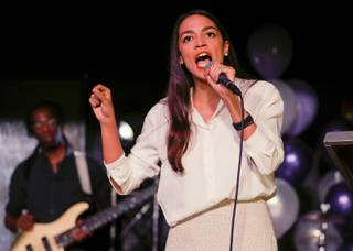 New York Democratic Congressional candidate Alexandria Ocasio-Cortez speaks to supporters, Tuesday, Nov. 6, 2018 in Queens the Queens borough of New York, after defeating Republican challenger Anthony Pappas in the race for the 14th Congressional district of New York. (AP Photo/Stephen Groves)