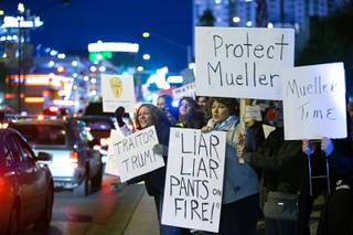 Activists protest in front of the Lloyd D. George Federal Building in downtown Las Vegas Thursday, Nov. 8, 2018. Following the firing of U.S. Attorney General Jeff Sessions, activists are asking that the investigation into alleged Russian interference in the 2016 elections is protected.