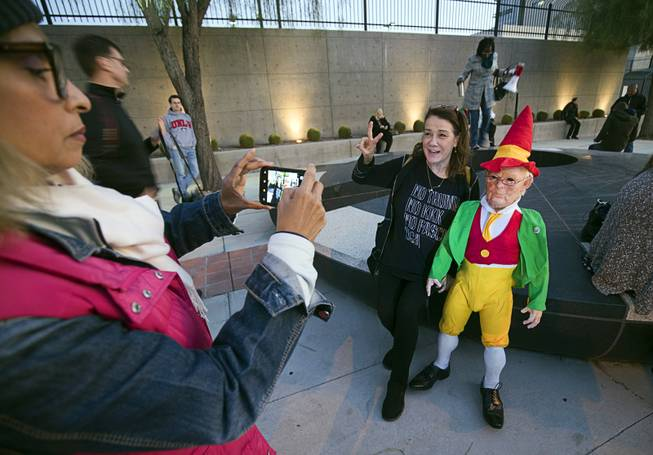 "Valerie Carpenter has her photo taken with an elvish Donald Trump, created by artist Joshua ""Ginger"" Monroe, during a protest in front of the Lloyd D. George Federal Building in downtown Las Vegas Thursday, Nov. 8, 2018. Following the firing of U.S. Attorney General Jeff Sessions, activists are asking that the investigation into alleged Russian interference in the 2016 elections is protected."