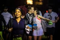 "More than 100 couples participated in the event's ""run-thru weddings,"" a roped-off area on the north end of the Strip where runners of the half and full marathons who applied in advance had their vows read and were issued ..."