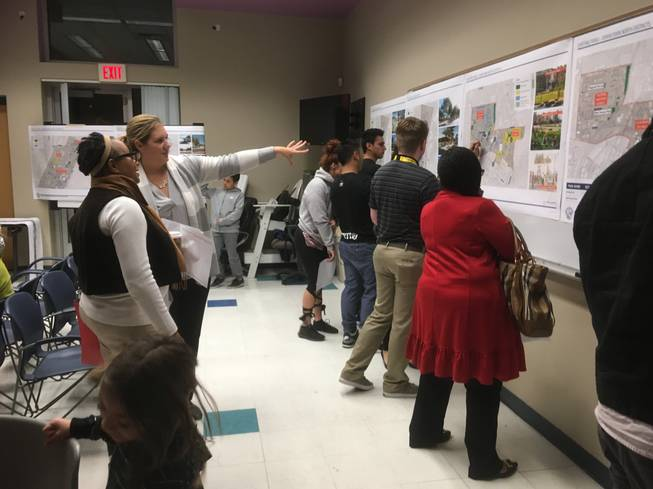 Las Vegas community members examine the maps of proposed improvements to downtown parks at a public meeting Wednesday at the Municipal Pool.