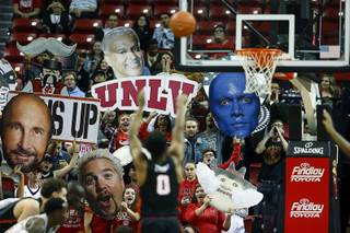 Fans try to distract Pacific's Jahlil Tripp as he shoots a free throw during a game against UNLV at the Thomas & Mack Center Tuesday, Nov. 20, 2018.