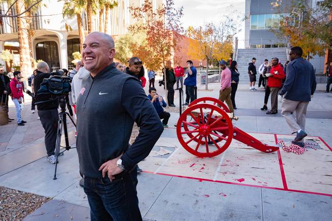 UNLV Head Coach Tony Sanchez smiles with the repainted Fremont Cannon behind him at UNLV, Monday, Nov. 26, 2018. The Rebels won the Fremont Cannon during a game against UNR on Saturday.