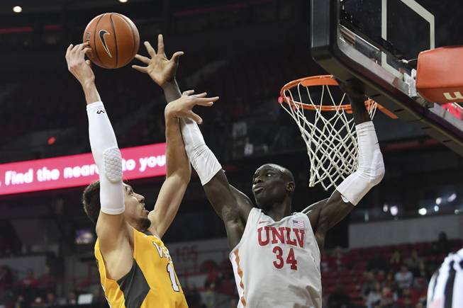 UNLV Rebels forward Cheikh Mbacke Diong (34) blocks a shot by Valparaiso Crusaders center Jaume Sorolla (14) during their game Wednesday, November 28, 2018, at the Thomas & Mack Center in Las Vegas.