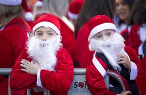 Ryder Jay, left, 7, and his friend Finn Walsh, 6, watch pre-run performances during the 14th Annual Las Vegas Great Santa Run in downtown Las Vegas Saturday Dec. 1, 2018. The event raises funds for Opportunity Village's programs and services, which provide support to Southern Nevada residents with disabilities and their families.
