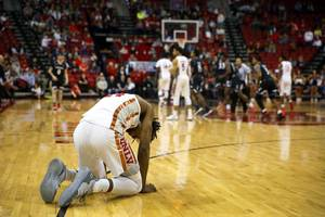 UNLV Rebels forward Joel Ntambwe (24) is slow to get up from the court after an injury in the final moments of a game against the Cincinnati Bearcats at the Thomas & Mack Center Saturday Dec. 1, 2018. The Bearcats beat the Rebels 65-61.
