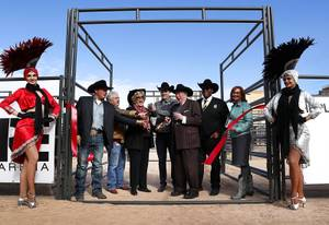 Dignitaries react as Las Mayor Carolyn Goodman cuts a ribbon too early during the grand opening of the Plaza's Core Arena, a permanent equestrian arena west of Las Vegas City Hall, in downtown Las Vegas Tuesday, Dec. 4, 2018. From left: Rodeo professional Matt Shiozawa, City Councilman Bob Coffin, Las Vegas Mayor Carolyn Goodman, Plaza CEO Jonathan Jossel, former Mayor Oscar Goodman, City Councilman Cedric Crear, and Sallie Doebler of the Las Vegas Metro Chamber of Commerce.