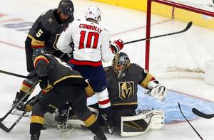 Washington Capitals right wing Brett Connolly (10) runs into Vegas ...