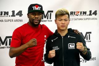 Floyd Mayweather Jr., left,poses with Japanese kickboxer Tenshin Nasukawa during a news conference at the Mayweather Boxing Club in Las Vegas Thursday, Dec. 6, 2018. Mayweather is scheduled to fight Nasukawa in a three-round exhibition match in Japan on New Year's Eve.