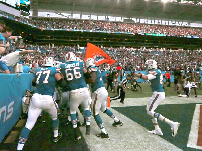 Dolphins beat Pats on miracle