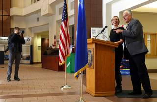 Governor-elect Steve Sisolak shares the podium with Heather Korbulic, executive director of Silver State Health Insurance Exchange, during a news conference on health insurance at the Sawyer State Building Friday, Dec. 14, 2018. The deadline for enrolling for health insurance through Nevada Health Link (www.nevadahealthlink.com) is midnight Saturday, Dec. 15.