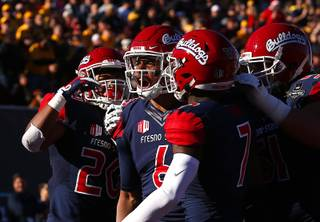 Fresno State quarterback Marcus McMaryion (6) celebrates with teammates after a scoring a touchdown against Arizona State University during the Mitsubishi Motors Las Vegas Bowl at Sam Boyd Stadium Saturday, Dec. 15, 2018. Fresno State beat ASU 31-20. STEVE MARCUS