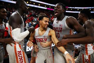 UNLV Rebels guard Noah Robotham (5) celebrates with his team after making a 3-pointer in overtime to defeat BYU, 92-90, during the Neon Hoops Coaches vs Cancer benefit game at T-Mobile Arena, Saturday, Dec. 15, 2018.