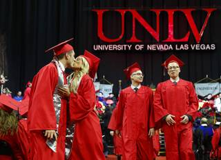 Jordan Rodriguez kisses his wife Christina as they graduate together during UNLV's Winter Commencement at the Thomas & Mack Center Tuesday, Dec. 18, 2018. Graduates ranged in age from 20 to 72 years old with 63 percent of graduates coming from ethnically diverse backgrounds.