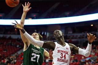 UNLV Rebels forward Cheikh Mbacke Diong (34) and Colorado State Rams forward Logan Ryan (21) reach for the ball during a game at Thomas & Mack, Wednesday, Jan. 2, 2019.
