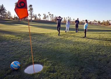 Malik Rafih, left, 14, reacts as his ball misses the cup during a game of FootGolf at Chimera Golf Club in Henderson Friday, Jan. 4, 2019. FootGolf combines soccer and golf and is played with soccer balls with 21-inch diameter cups.