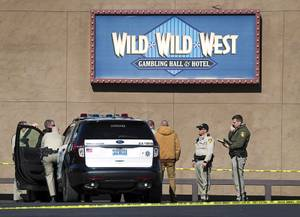 Metro Police investigate after a shooting at the Wild Wild West on Tropicana Avenue Friday, Jan. 4, 2019.
