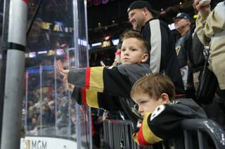 Hockey fans watch as the Vegas Golden Knights warm-up on the ice before their game against the New York Rangers, Tues. Jan 8, 2018.