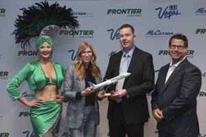 From left, Frontier Airlines Vice President of Marketing Tyri Squyres, Clark County Department of Aviation Airport Chief Marketing Officer Chris Jones and LVCVA Vice President of International Marketing Michael Goldsmith pose for a photo during an announcement by Frontier Airlines and McCarran International Airport of five new Frontier routes to Las Vegas Tuesday, January 8, 2019, at the Thomas & Mack Center.