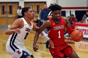 Coronado player Jaden Hardy (1) works to get around Liberty ...