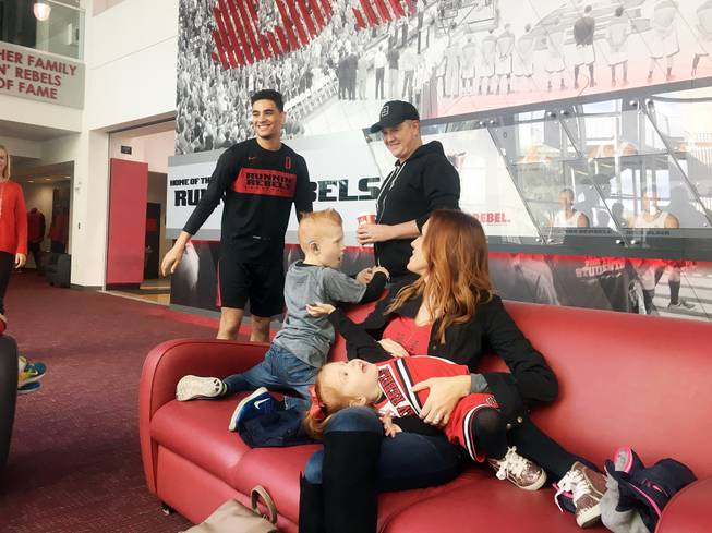 The Sassman family — parents Eric and Marie, 6-year-old Evan and 2-year-old Fiona — meet Jay Green, left, a guard for the UNLV men's basketball team, on Jan. 6 at a community event sponsored Nevada Hands and Voices.