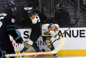 Vegas Golden Knights center Jonathan Marchessault (81) is upended by ...