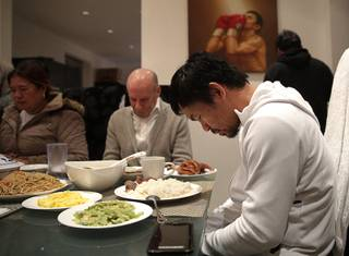 Boxer Manny Pacquiao prays before breakfast at his home following his morning run Monday, Jan. 14, 2019, in Los Angeles. Breakfast at Manny Pacquiao's house began with a silent prayer, followed by more silence around the big dining room table as his entourage waited for the fighter to take the first bite.