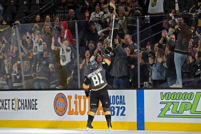 Vegas Golden Knights center Jonathan Marchessault (81) hands a game stick to a young fan after his team defeats the Pittsburgh Penguins, 7-3, during an NHL hockey game at T-Mobile arena Saturday, Jan. 19, 2019.