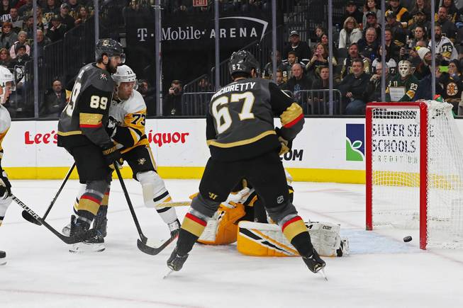 The Vegas Golden Knights score against the Pittsburgh Penguins during the first period of an NHL hockey game at T-Mobile arena Saturday, Jan. 19, 2019.