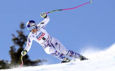 United States' Lindsey Vonn speeds down the course during an alpine ski, women's World Cup super-G in Cortina D'Ampezzo, Italy, Sunday, Jan. 20, 2019.