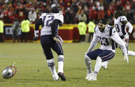 New England Patriots quarterback Tom Brady (12) celebrates with middle linebacker Kyle Van Noy (53) after defeating the Kansas City Chiefs in AFC Championship NFL football game in overtime, Sunday, Jan. 20, 2019, in Kansas City, Mo.