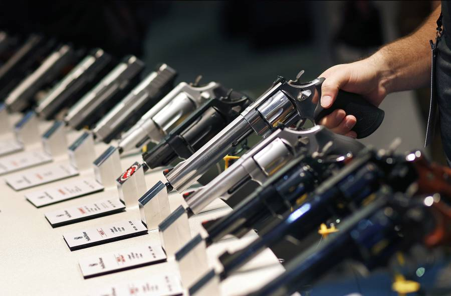 In this Jan. 19, 2016, file photo, handguns are displayed at the Smith & Wesson booth at the Shooting, Hunting and Outdoor Trade Show in Las Vegas.