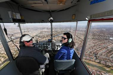 Steve Adams pilots the Carnival AirShip over the northwest Las Vegas Valley Thursday, Feb. 7, 2018. Las Vegas Weekly reporter Cindi Reed is at right. The Airship is on tour to celebrate Carnival Panorama, Carnival Cruise Line's new ship, which will homeport in Long Beach, Calif.