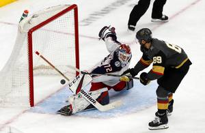 Columbus Blue Jackets goaltender Sergei Bobrovsky (72) deflects a shot by Vegas Golden Knights right wing Alex Tuch (89) during the first period at T-Mobile Arena Saturday, Feb. 9, 2018.