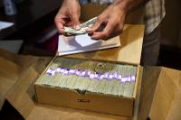 Bank officials and others urged Congress on Wednesday to fully open the doors of the U.S. banking system to the legal marijuana industry, a change that supporters say would reduce ...