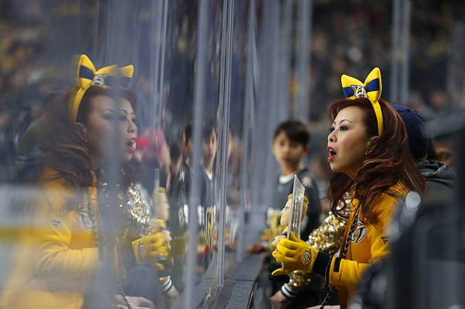 A Nashville fan cheers for the Predators during the third period of their game against the Vegas Golden Knights at T-Mobile Arena Saturday, Jan. 16, 2019.