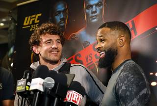 Ben Askren, left, and Tyron Woodley talk to reporters during open workouts for UFC 235 at the MGM Grand Thursday, Feb. 28, 2019. UFC 235 takes place at T-Mobile Arena on Saturday.