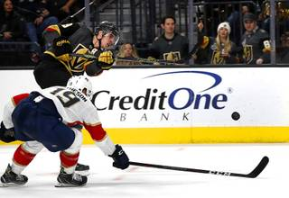 Vegas Golden Knights right wing Reilly Smith (19) scores past Florida Panthers defenseman Mike Matheson (19) during the third period at T-Mobile Arena Thursday, Feb. 28, 2019.