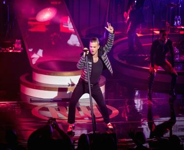 "Robbie Williams performed as his Robbie Williams persona for nearly two hours Wednesday night at Encore Theater, the first of 15 headlining shows at Wynn Las Vegas, but after singing his best-selling single ""Angels"" he seemed to come out of character if only for a moment ..."