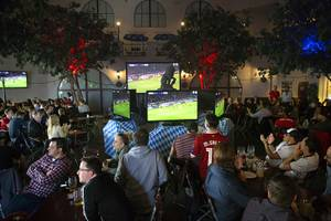 Soccer fans watch a game between FC Liverpool and Bayern ...