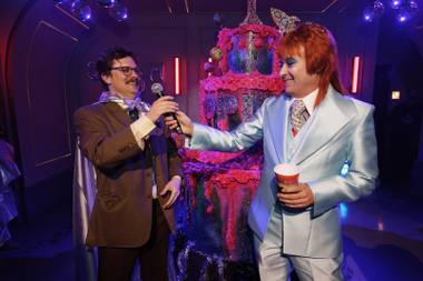 "Spiegelworld founder Ross Mollison was dressed like David Bowie from the ""Life on Mars?"" video, and producer Howie M. Howie was in a VIP room before the show taking a bath, sudsing himself with a loofah before a room full of Vegas socialites."