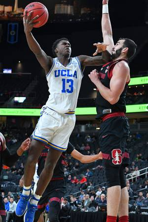 UCLA Bruins guard Kris Wilkes (13) is defended by Stanford ...