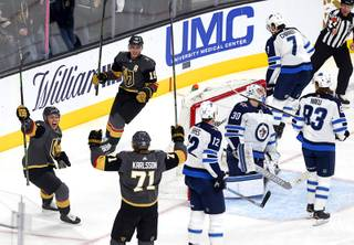 Jonathan Marchessault (81), Reilly Smith (19) and William Karlsson (71) celebrate a goal by Karlsson in the first period against the Winnipeg Jets at T-Mobile Arena Thursday, March 21, 2019.