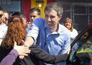 Democratic presidential candidate Beto O'Rourke of Texas reaches out to a supporter during a campaign stop at Arandas Taqueria on North Nellis Boulevard Sunday, March 24, 2019.