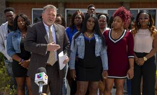 Attorney Brent Bryson, left, and Taccara Brooks, center, talk with reporters during a news conference outside the Brent Bryson law office Friday, April 5, 2019. Brooks filed a lawsuit against the Metro Police Department in connection with the death of her 16-year-old son Anthony Garrett in 2017.
